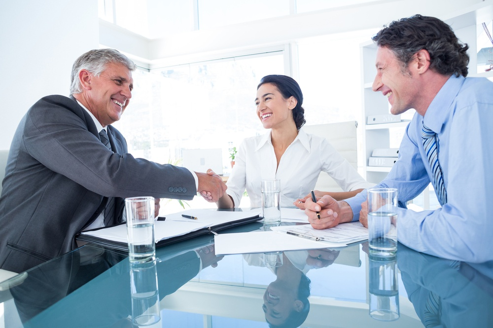 Business people reaching an agreement in an office.jpeg