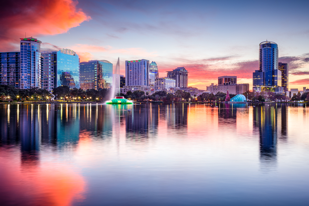 Orlando, Florida, USA skyline at Eola Lake.